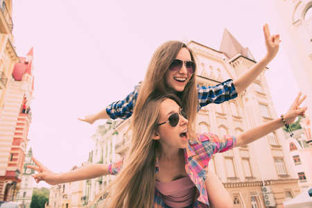 happy  beautiful girls love to travel and fooling around
