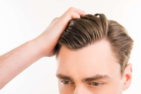 Photo for Close up photo of healthy man combing his hair with fingers - Royalty Free Image