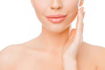 Photo pour Close up of woman with perfect skin applying cream on face - image libre de droit