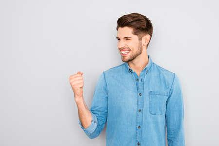 Photo pour Yes! Happy successful young businessman showing fist - image libre de droit
