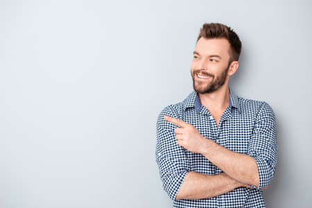 Photo for Cheerful handsome man showing direction and pointing with finger - Royalty Free Image