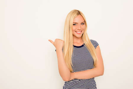 Cheerful young woman showing way on white background