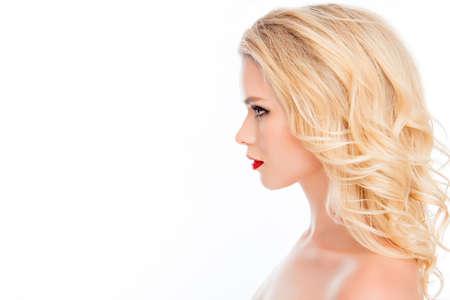 Photo pour Side view portrait of beautiful blonde with modern hairstyle - image libre de droit