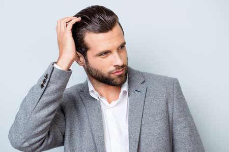 Photo pour Close up portrait of handsome confident masculine man in jacket touching his hair - image libre de droit