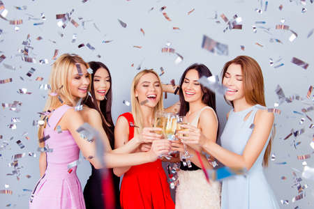 Cheers to the openning of the dream place! Five excited girlfriends are toasting, all in colorful dresses, so cute, charming, festive. Shiny silver confetti is in the air! Amazing