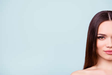 Photo pour Halfface portrait of pretty lady with healthy skin, hair, looking straight in the camera, standing on the pure background, near the copyspace - image libre de droit
