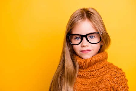 Foto de Health care, eyeball check, clear vision, youngsters concept. Close up portrait of charming blonde schoolgirl in fashionable black specs, knitted handmade warm outfit, intelligent and concentrated - Imagen libre de derechos