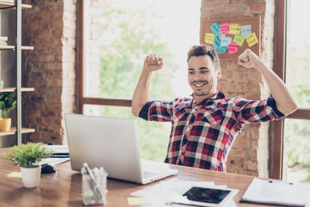 Photo for Yes! I did it! A dream of the young hipster freelancer entrepreneur came true. He is very excited, amazed, shocked, wearing smart casual, celebrating in the office - Royalty Free Image