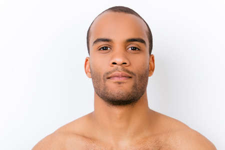 Photo for Hygiene, vitality, beauty, men life concept. Close up portrait of afro young nude guy with stubble isolated on pure white background, harsh and virile - Royalty Free Image