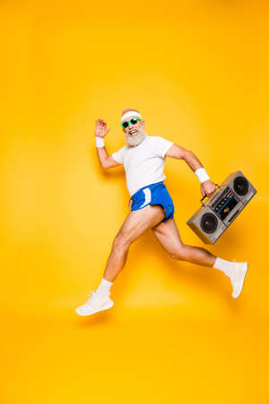 Photo pour Dreamy cheerful excited sporty aged funny sexy grandpa in eyewear with recorder in hand. Old school, swag, fooling qround, gym, technology, success, hip hop, chill, party, leisure - image libre de droit