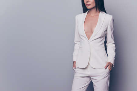 Foto de Cropped shot of hot gorgeous well dressed by formal dress code stunning charming business lady, standing on pure light background, with arms in pockets of classic pants - Imagen libre de derechos