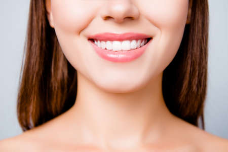 Photo pour Concept of healthy wide beautiful smile. Cropped close up photo of healthy without caries shiny toothy woman's smile, isolated on grey background - image libre de droit