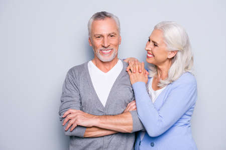 Foto de Happy excited lovely tender gentle cute elderly people are smiling and embracing, isolated on grey background - Imagen libre de derechos