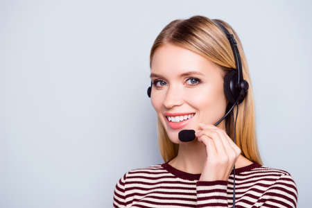 We have the best service and are ready to help you immediately! Close up portrait of happy cheerful clever polite operator of call center, isolated on grey background