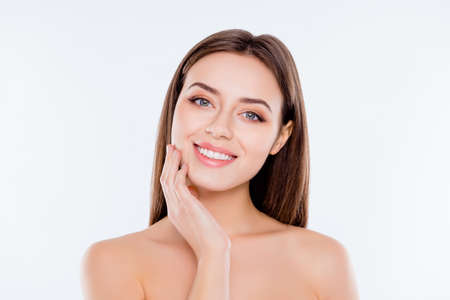 Photo for Clean clear pampering wellness freshness rejuvenation concept. Close up portrait of beautiful tender cute pure girl touching her smooth soft flawless perfect skin on cheek isolated on white background - Royalty Free Image
