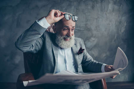 Foto de Attractive, laughing boss in suit take off glasses, look, watch, read conical facts, information in newspaper - Imagen libre de derechos