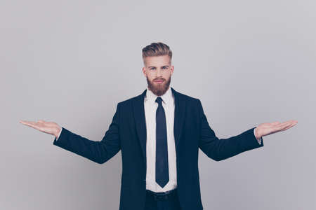 Photo for Handsome serious attractive expert experienced qualified leader brutal pensive confident concentrated man wearing black suit with white shirt demonstrating empty blank place isolated gray background - Royalty Free Image