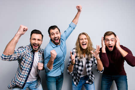 Photo pour Cheerful funky joyful buddies raise hands fists, checkered casual clothes, isolated on gray background - image libre de droit