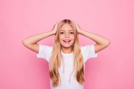 Education holiday elementary pre teens event party celebrate concept. Portrait of shocked charming beautiful cute sweet lovely tender gentle with long smooth straight hair isolated on pink backgroundの写真素材