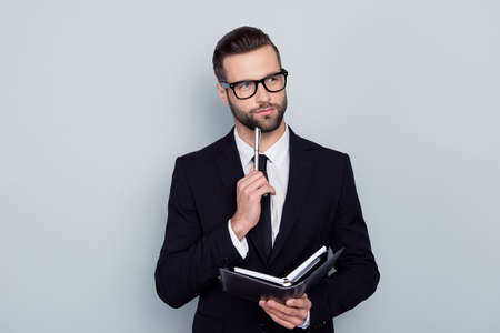 Photo pour Writer thinker author journalist essay concept. Portrait of pensive smart clever intelligent inspired handsome employee imaging writing new project isolated on gray background copy-space - image libre de droit