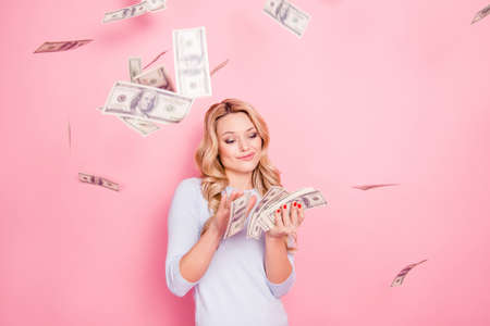 Photo for Portrait of carefree girlfriend, student wasting stack of much money, winner in casino lottery, having a lot of hundred dollars isolated on pink background - Royalty Free Image