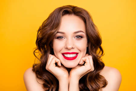 Photo pour Closeup portrait of pretty elegant girl with straight white teeth modern hairstyle isolated on yellow background demonstrate perfect make up for event holiday birthday - image libre de droit