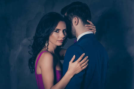 Photo pour Portrait of beautiful pretty charming woman with curls looking at camera touching mysterious man with bristle in tux isolated on grey background, feminism adultery posh evening concept - image libre de droit