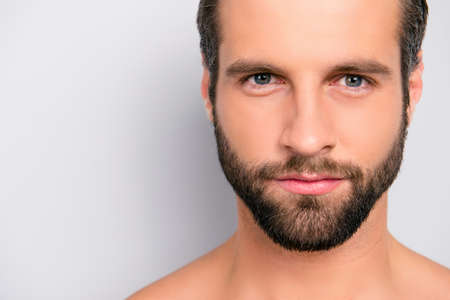 Photo pour Close up cropped portrait with copy space of virile, harsh, manly, attractive, naked, unshaven, handsome, stunning man with ideal, perfect face skin, looking at camera, isolated on gray background - image libre de droit