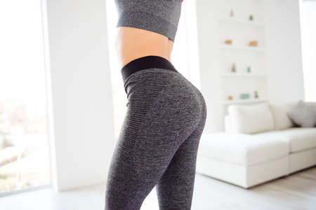 Photo pour Weightloss wellness eating nutrition vitality concept. Cropped close up view photo of sexual sporty sportive tempting beautiful attractive nice round ass wearing gray tight pants leggings - image libre de droit