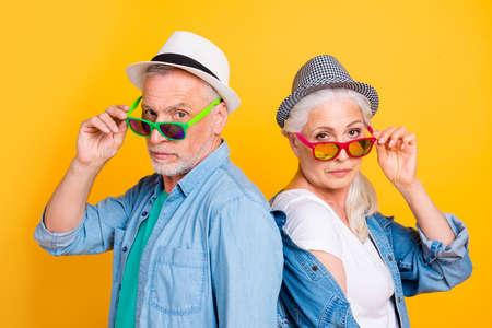 Foto de Listen to us you small little kid! We run this world! Close up photo portrait of joking funky cool stylish trendy chic he and she touching green red eyewear isolated on bright background - Imagen libre de derechos
