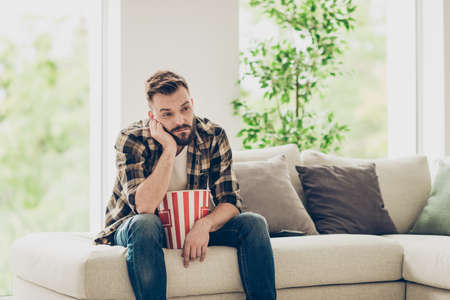 Photo pour Bearded brunet tired man in checkered shirt and denim jeans look - image libre de droit