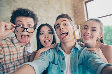 Self-portrait of four cheerful funky childish comic people, guys