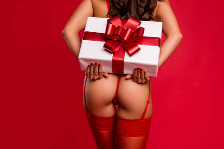 Time to give present. Back behind rear view close up cropped photo of lovely gorgeous, stunning beautiful lady hold big white box package isolated on shine red background with copy space for text