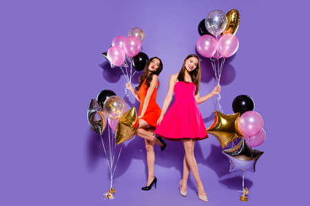 Photo pour Congratulations, greeting concept. Full length, legs, body, size portrait of two people person in fuchsia, red formal wear on sharp, pumps, stilettos isolated on bright purple background - image libre de droit