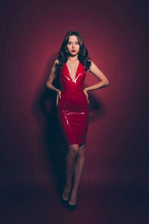 Full length body size vertical elegant brunette wearing red dress