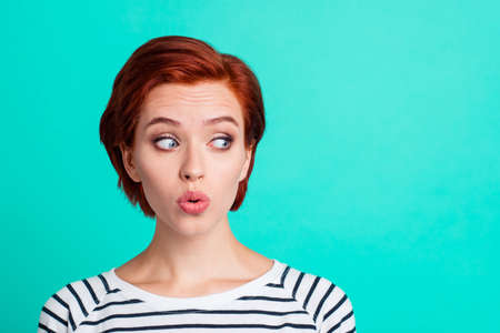 Photo pour Close-up portrait of nice funny charming attractive lovely sweet red-haired lady in striped pullover air blow pouted lips looking aside isolated over bright vivid shine green turquoise background - image libre de droit