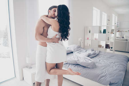 Photo pour A couple in white towel hugging and kissing each other - image libre de droit