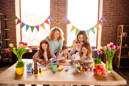 Photo pour Portrait of nice attractive adorable lovely focused concentrated cheerful cheery girls making decor things carefully on table in house brick loft industrial interior room - image libre de droit