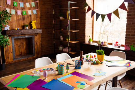 Photo pour Table with handicraft materials in decorated house festive preparation brick loft industrial interior room indoors - image libre de droit