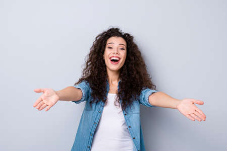Photo pour Portrait of her she nice-looking cute pretty lovely winsome charming attractive girlish cheerful wavy-haired girl widely opened hug hands isolated over gray pastel background - image libre de droit