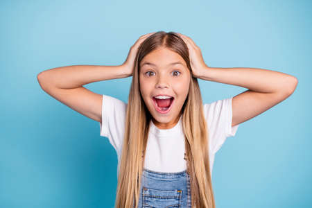 Photo for Close-up portrait of her she nice cute lovely sweet attractive funny cheerful cheery straight-haired blonde pre-teen girl opened mouth overjoy isolated on blue pastel background - Royalty Free Image