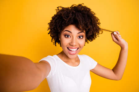 Photo pour Close up photo beautiful amazing she her dark skin lady arm hand show healthy curl advising use shampoo conditioner wear casual white t-shirt isolated yellow bright vibrant vivid background - image libre de droit