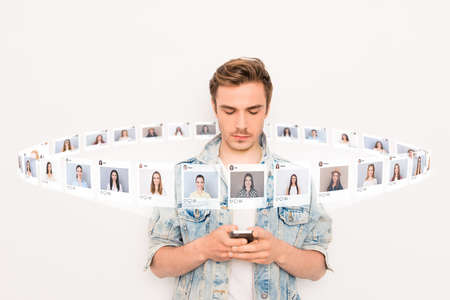 Photo pour Close up photo interested he him his guy hold smartphone addicted online sit internet pick choose choice illustration pictures girls dating site futuristic creative design isolated white background - image libre de droit