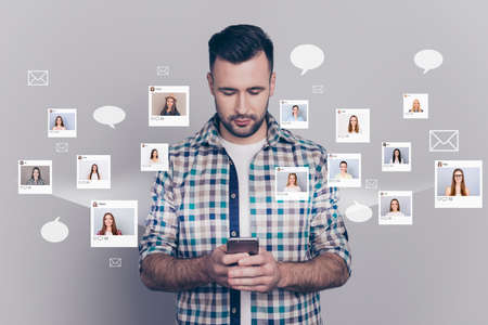 Photo pour Close up portrait fellow buddy he his him hold look telephone texting sms different ladies pictures illustration global search  innovation microblogging isolated grey background - image libre de droit