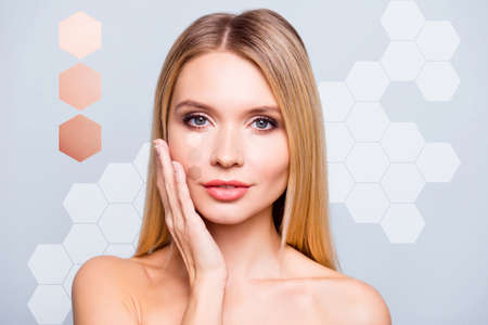 Foto de Close-up portrait of nice well-groomed attractive nude naked blonde lady touching smooth flawless fresh perfect clean clear skin advert honey cells isolated over grey blue background - Imagen libre de derechos