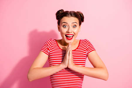 Photo for Close up photo funky beautiful she her lady pretty hairdo two buns hold hands arms together I need buy buyer these all daddy mommy wear casual striped red white t-shirt isolated pink background - Royalty Free Image