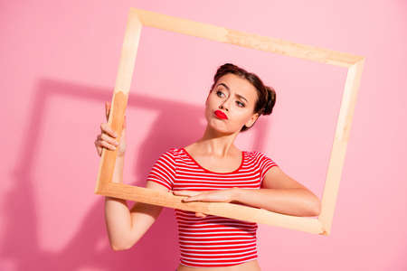 Photo for Portrait of her she nice-looking cute charming attractive glamorous bossy funny playful girl in striped t-shirt holding in hands wooden frame film movie posing isolated on pink pastel background - Royalty Free Image