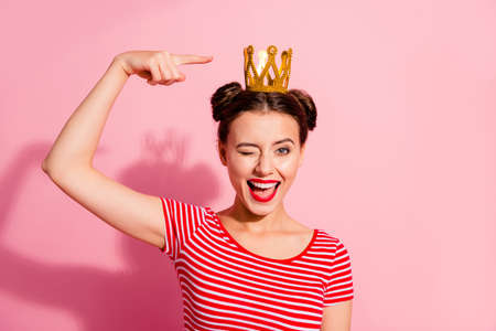 Foto de Close-up portrait of her she nice cute attractive lovely winsome gorgeous cheerful cheery glad flirty girl wearing striped t-shirt showing cool gold diadem isolated over pink pastel background - Imagen libre de derechos