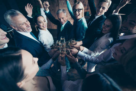 Photo pour Close up top above high angle photo business people different age race she her he him his excited amazed company hands arms raised up golden wine friendship friends formal wear jackets shirts - image libre de droit