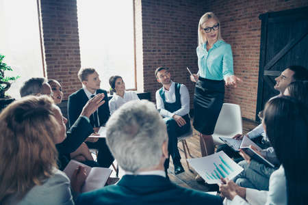Nice stylish elegant attractive busy serious experts listening to economist executive director financier corporate conference at modern industrial loft interior room work place space